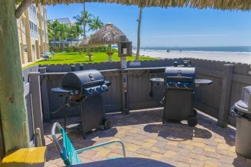gas grills in tiki hut on beach