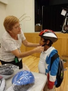 Child Being Fitted With Helmet